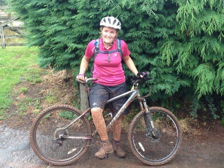 A photo of me on my mountain bike covered head to toe in mud
