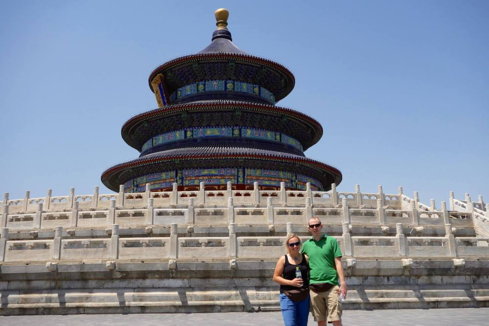 Photo of us standing in front the three tiered round Temple of Heaven in Beijing.