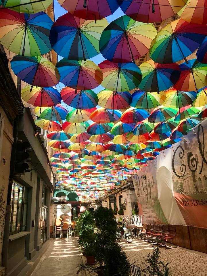 Colourful umbrellas providing shadow on a trendy street in Bucharest