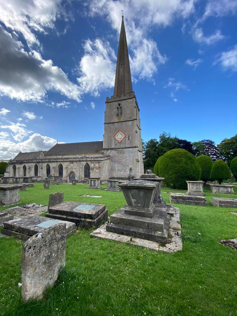 Painswick church with some graves in the foreground