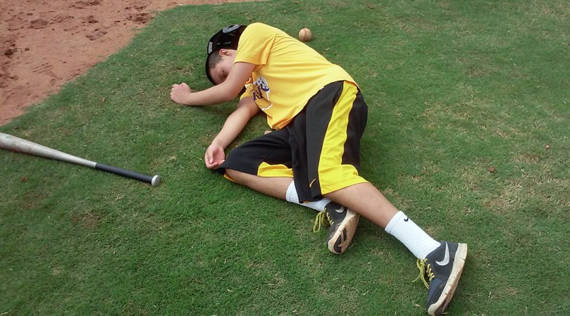 Guan Chen lying on the grass