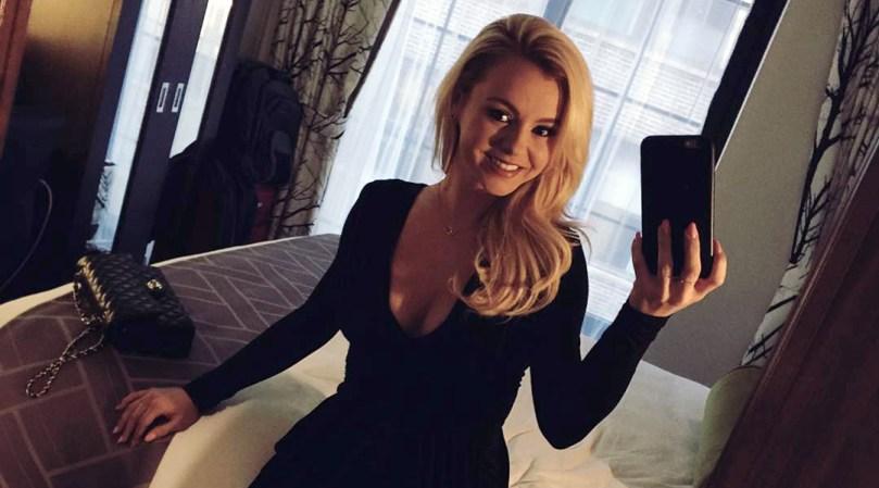 Bree Olson in a black dress taking an Instagram selfie