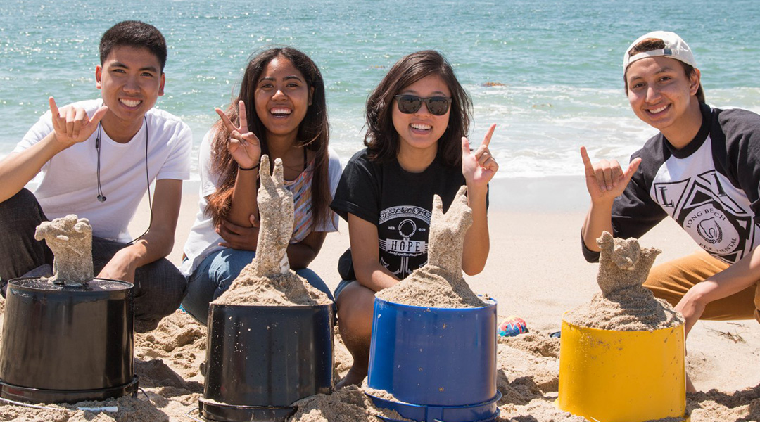 4 CSULB Students show off their plaster cast sculpltures