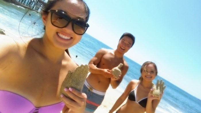 CSULB Students show off plaster castings at Seal Beach