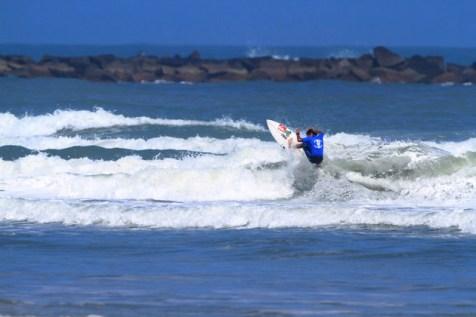 surfing at new smyrna inlet