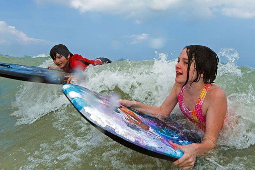 kids boogie boarding