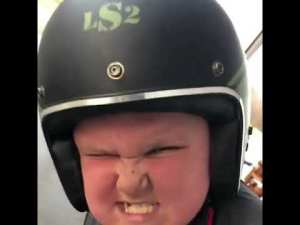 silly kid on bike