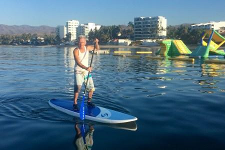 BeachBabyBob on a paddle board