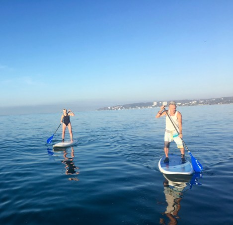 BeachBabyBob and Sue on paddle boards in Bucerias Mexico