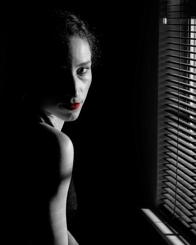 Abby lit thought the window in black and white with red lipstick!