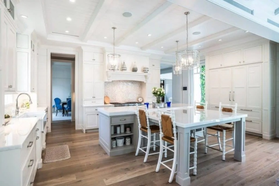 Beach House Kitchen Ideas - Kitchen With Gray Island and Built In Seating - White Elegance House Tour - White Elegant Coastal Decor Ideas