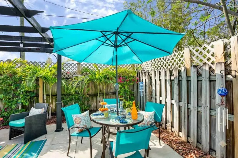 Beach Home Tour Coastal Decor Ideas The Succulent House Lake Worth Beach - Teal umbrella and chairs