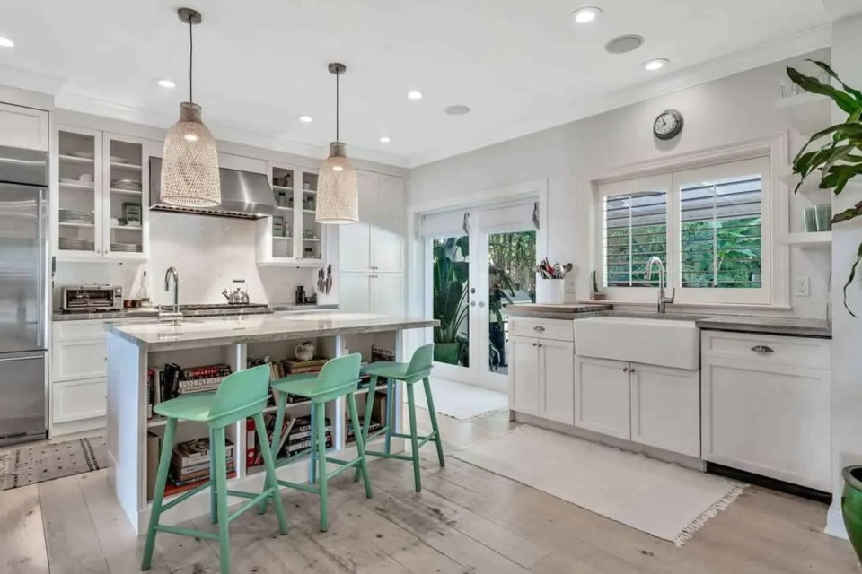 Elegant Bohemian Luxury Paradise AirBnb Beach House Decor - White kitchen with green bar stools