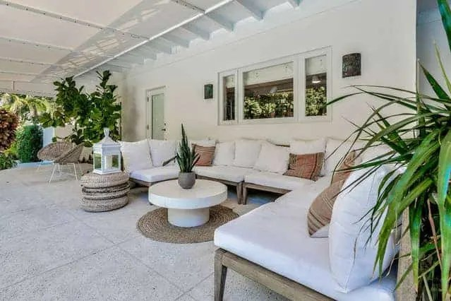 Beach House Outdoor Living Space Ideas - Light wood sectional with white cushions