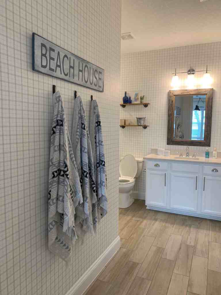 Beach Walk House Tour - Coastal Chic Design and Decor Ideas - bathroom with beach house sign
