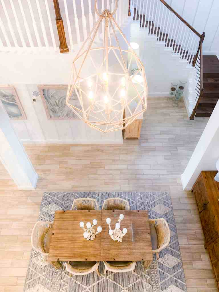 Beach Walk House Tour - Coastal Chic Design and Decor Ideas - Wicker chandelier over dining area