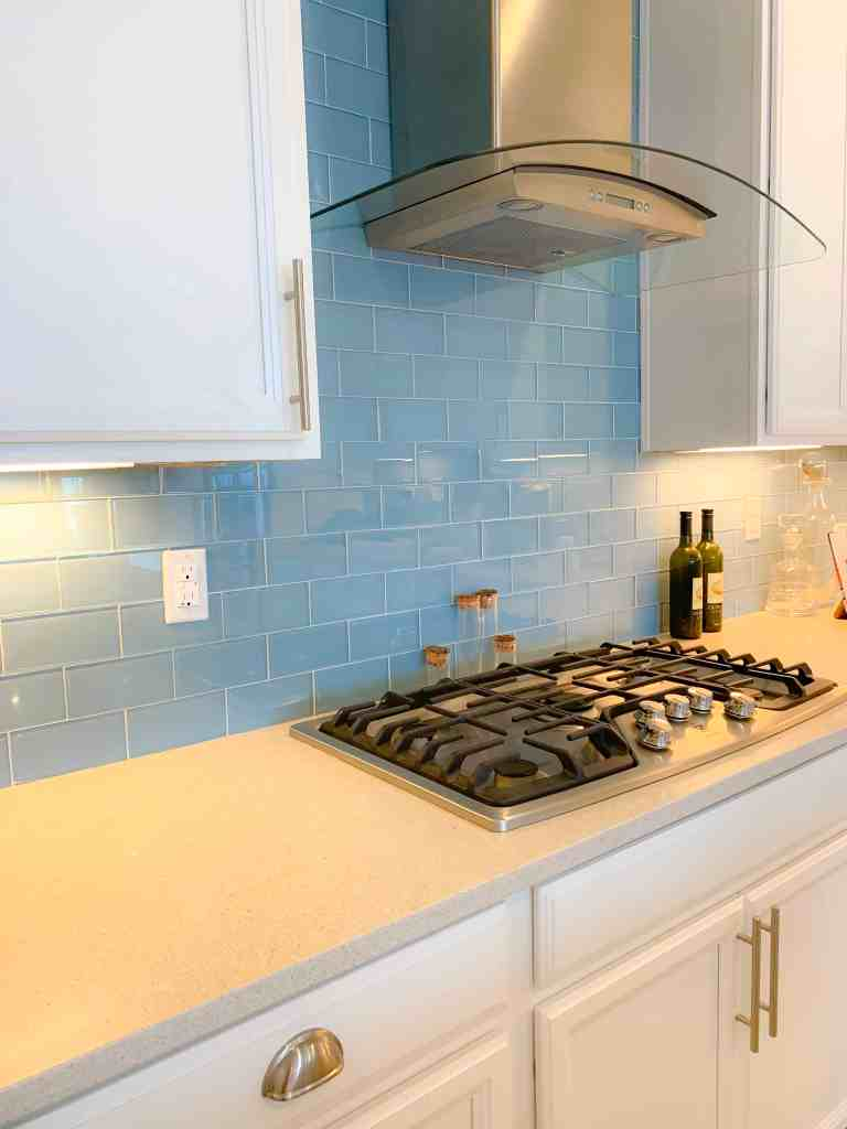 Beach Walk House Tour - Coastal Chic Design and Decor Ideas - Kitchen With Blue Backsplash