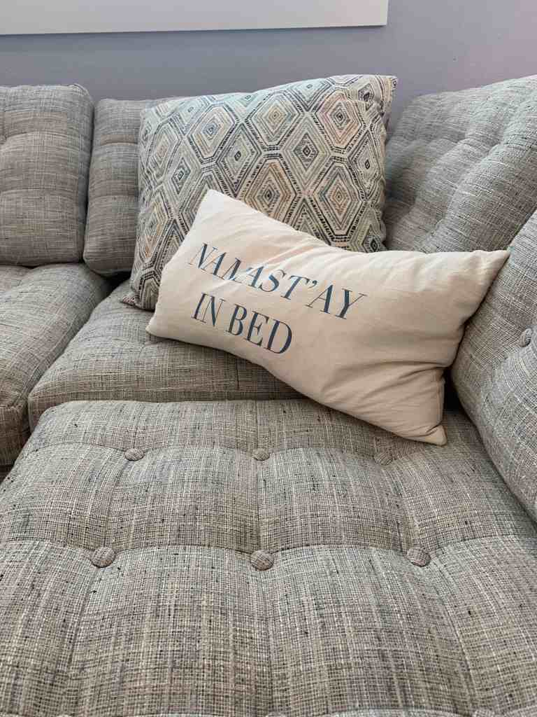 Beach Walk House Tour - Coastal Chic Design and Decor Ideas - Namastay in bed pillow on gray couch