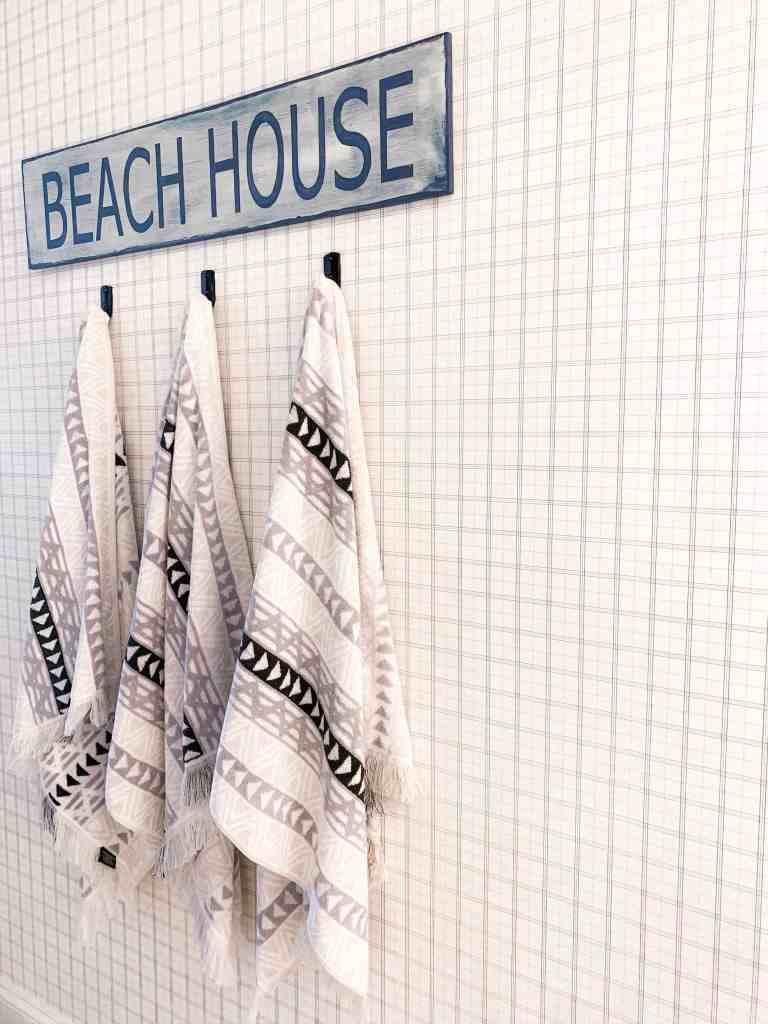 Beach Walk House Tour - Coastal Chic Design and Decor Ideas - beach house sign towel rack