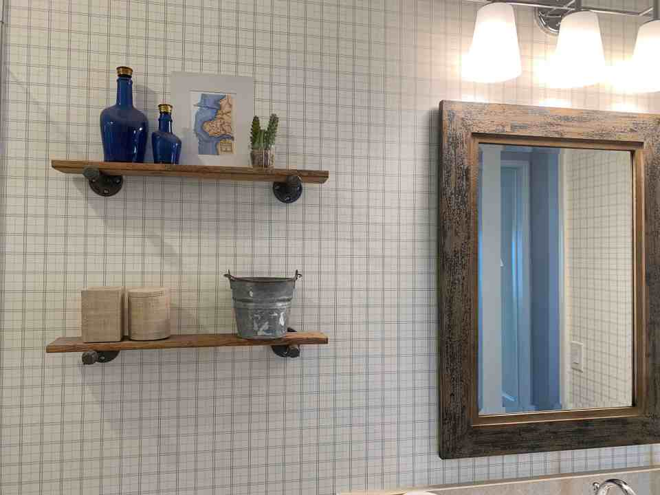 Beach Walk House Tour - Coastal Chic Design and Decor Ideas - mounted wood shelves over toilet
