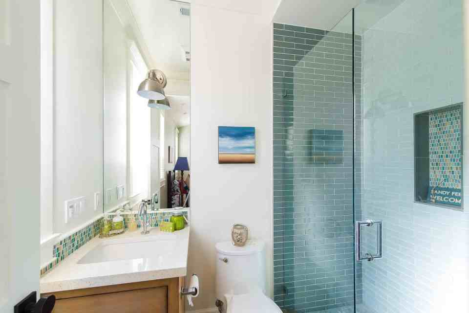 Blue Coastal Dream | Beach House Decor Ideas | Green subway tile in shower bathroom