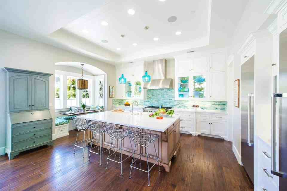 Blue Coastal Dream | Beach House Decor Ideas | White kitchen with medium wood island