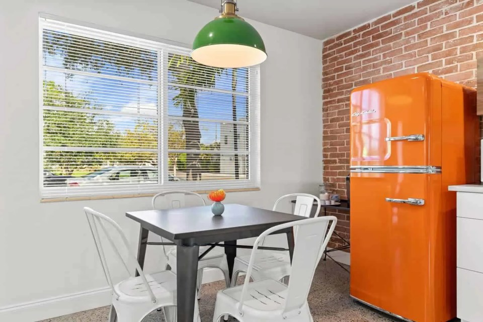 Orange Blossom Villa - Lake Worth Beach Airbnb Vacation Rental - Orange Retro Refrigerator