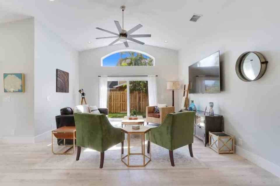 The Bent Palm Jupiter FL AirBnb Living Room with green chairs