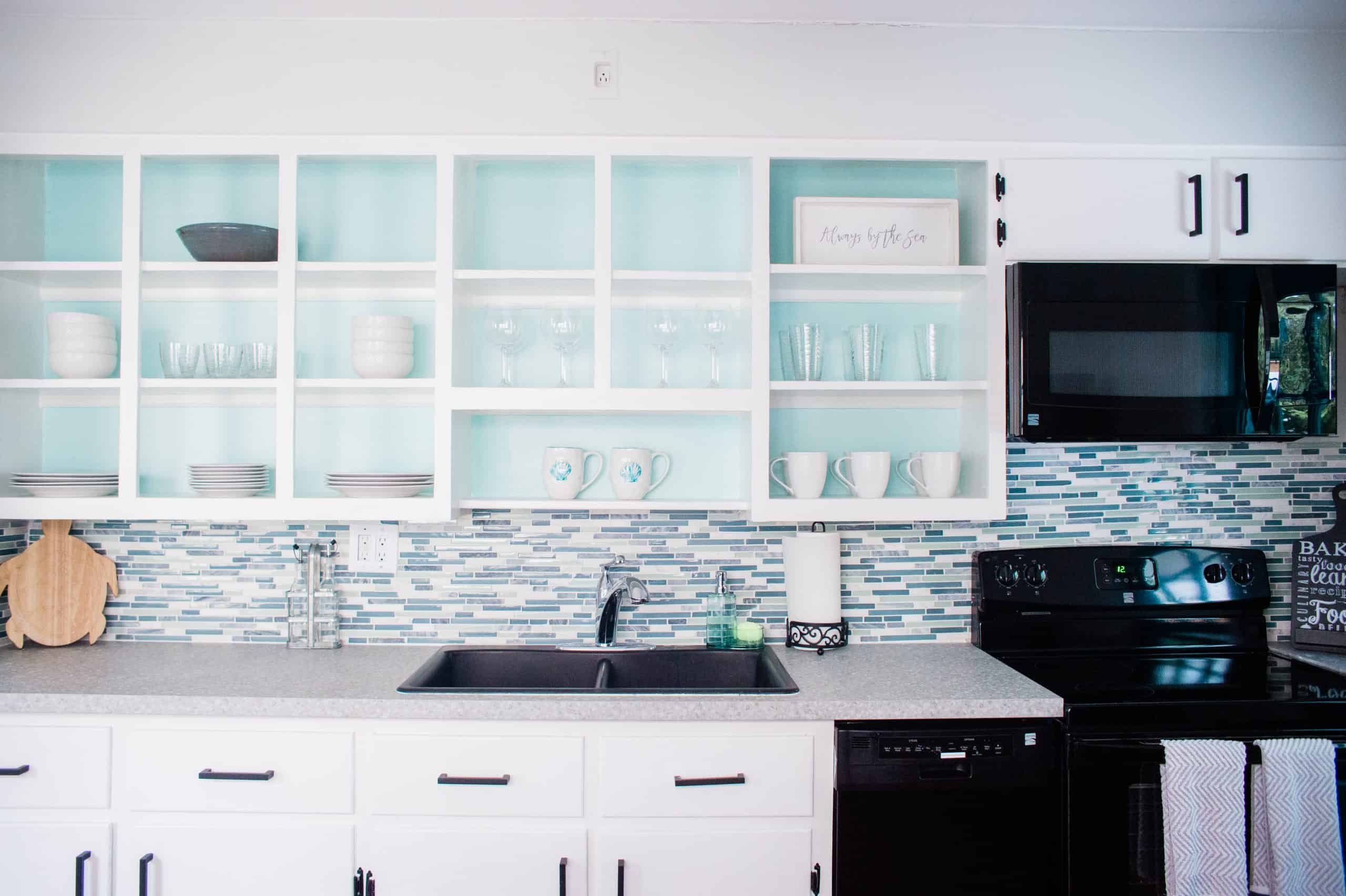 Open Kitchen Cabinets With Turquoise Blue Backs