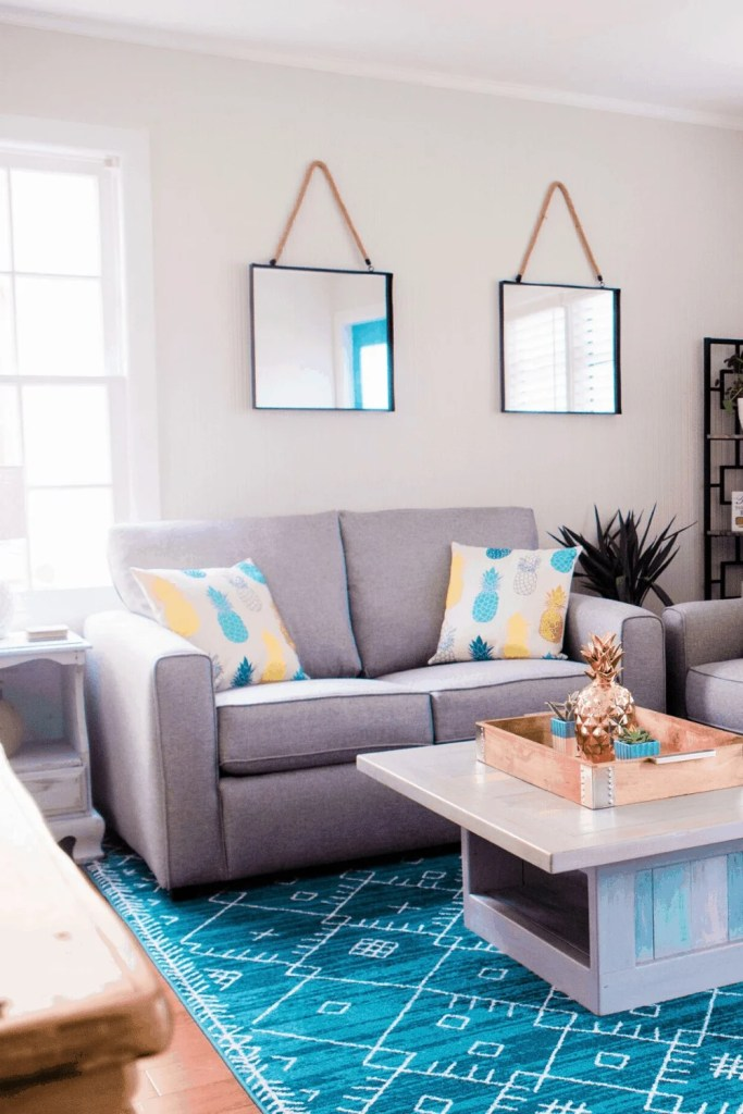 Beach Life Bungalow Living Room After Photo - Coastal Vibrant Transformation - AirBnb Makeover