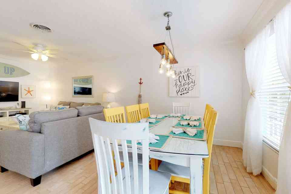 Tranquil Coastal Teal and Yellow Beach House Tour - Dining Room With Yellow Chairs