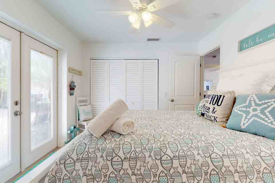 Tranquil Coastal Teal and Yellow Beach House Tour - Teal and Gray Fish Bedding