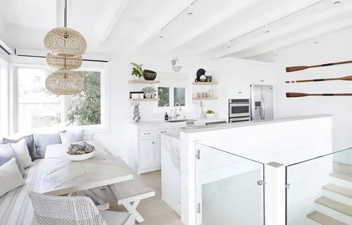 Upscale Coastal Bungalow - Airy Beach House Design - Kitchen and Dining Room Surf Style