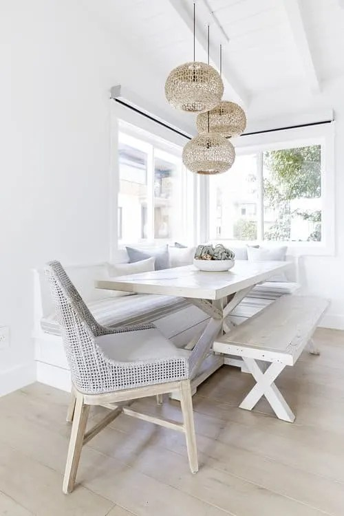 Upscale Coastal Bungalow - Airy Beach House Design - Eat in Kitchen White Wood Washed Table
