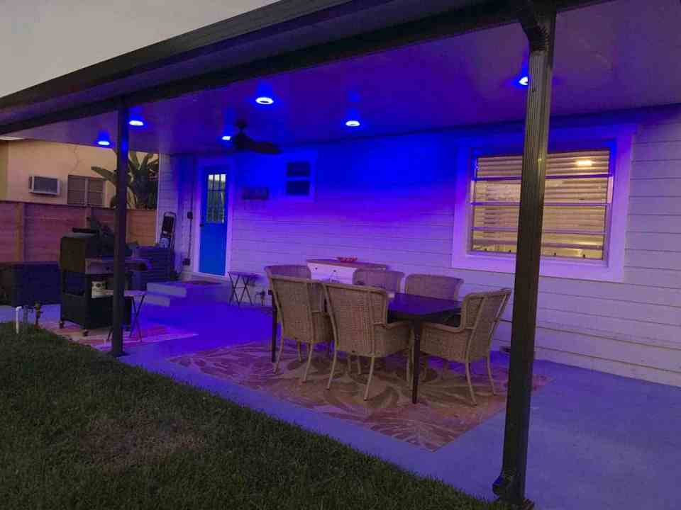 Backyard makeover - Covered patio with lights at night
