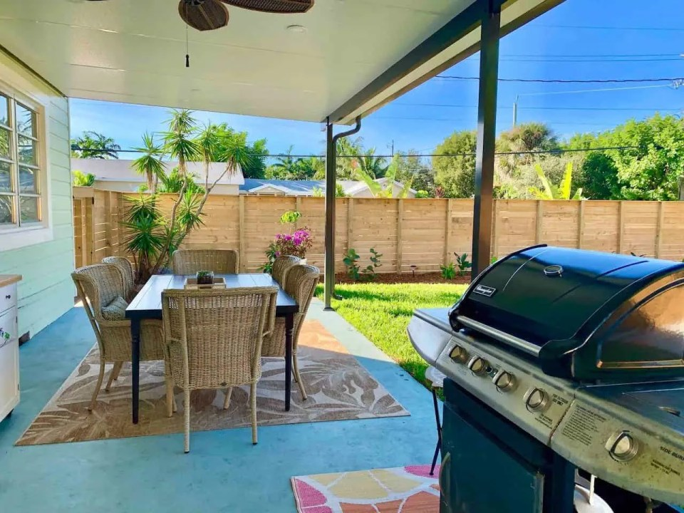 Backyard makeover - Covered patio area with table and grill