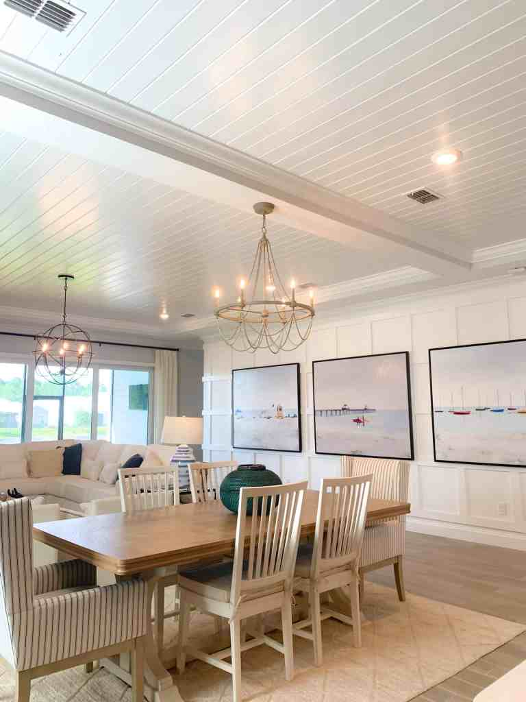 Coastal farmhouse dining room area with rustic elements
