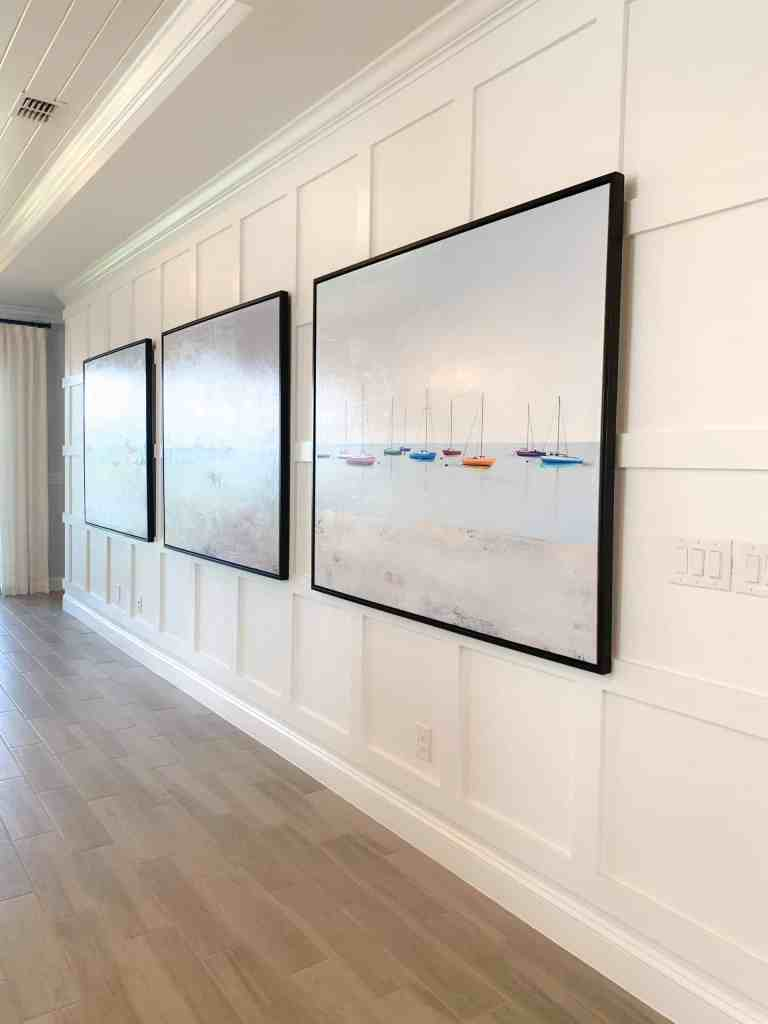 Gallery wall with sailboat art