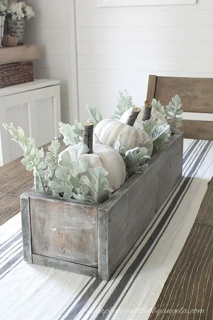 Rustic wood box centerpiece with a beach feel