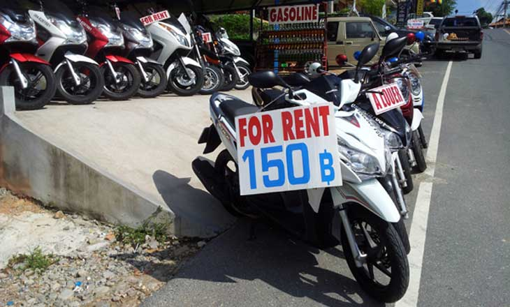 Koh Samui motorbike rental shop with several scooters for rent and price sign