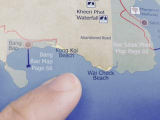Finger pointing on map showing Khlong Kloi Beach and Wai Chaek Beach (หวายแฉก) in southern Koh Chang, Thailand