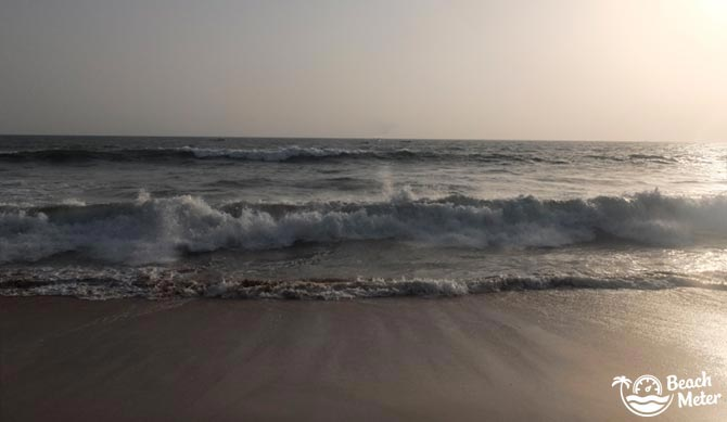 Big waves approaching and retracting on a beach in Goa during low season