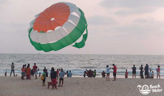 Parasailing at Benaulim Beach in Goa, India. The parachute has the colors of the Indian flag.