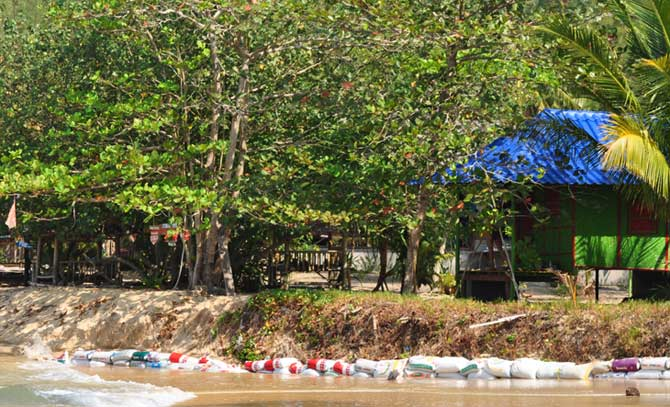Sandbags protect the beach and beach properties from erosion at Koh Phayam, Thailand