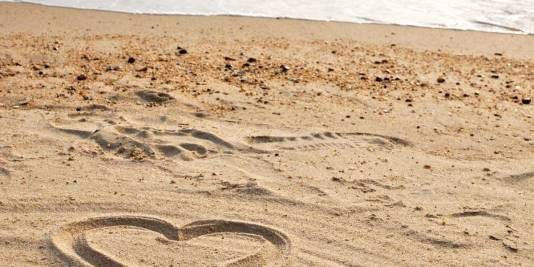Heart drawn in the sand with the sea in the background at Repulse Bay, Hong Kong
