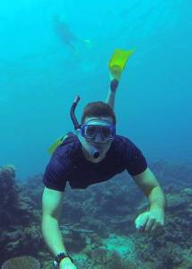 Man snorkeling with snorkeling mask and fins on the House Reef at Tureloto Beach in Northern Nias Island, Indonesia