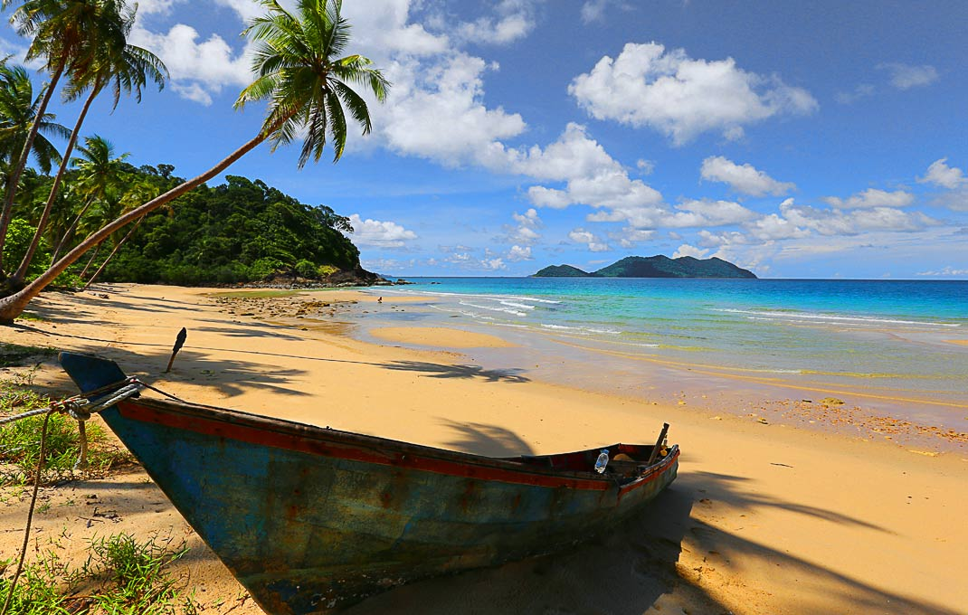 Old rusty boat on the deserted Wai Chaek Beach (Haad Wai Shak) of Koh Chang, Thailand