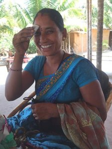 Indian beach seller from Goa touching the forehead with money for good luck