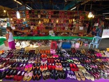 Numerous colorful sandals on display at Phuket Weekend Market