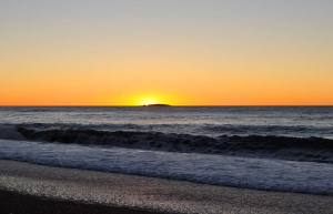 Amazing beach sunset at Haast Beach on the west-coast of New Zealand